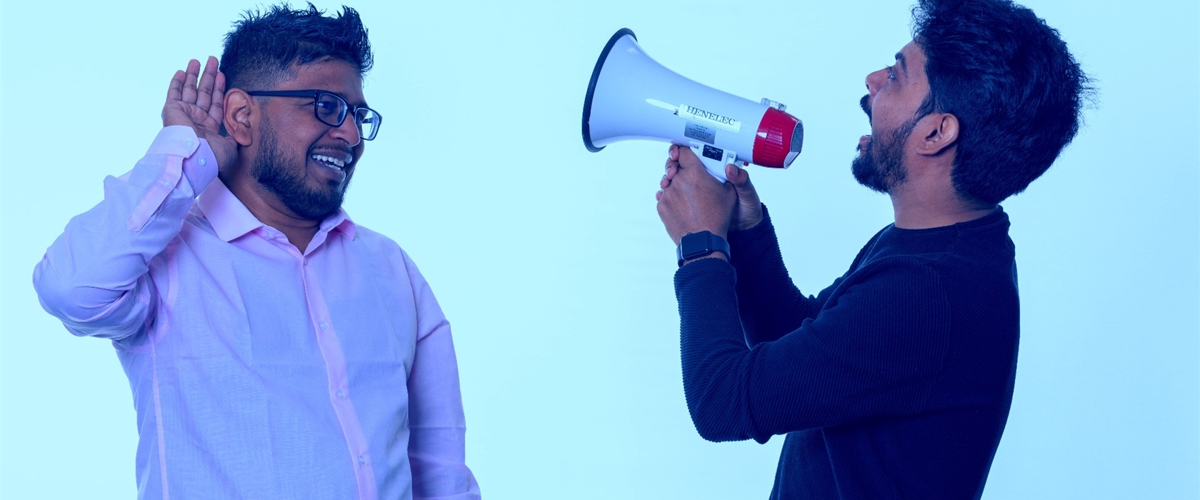 Avinash, Students' Union President and Omkar, Vice-President Business and Law, with a megaphone