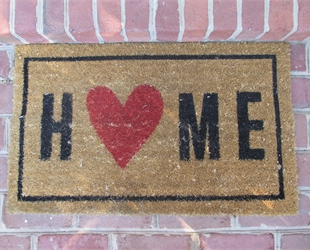 Welcome mat that some Home with a red heart as the 'O'