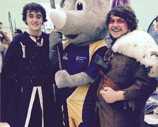 LASAR Treasurer and Business Development Officer standing with Ruskin Rhino, wielding a larp-safe Ax